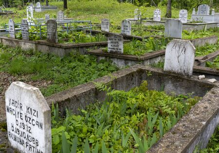 Turkey - May 3, 2019: Islamic graveyard with tombstones with many plants and trees