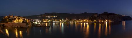 Amasra, Turkey - May 1, 2019: Panorama during the evening of the village of Amasra with harbor and the old twon on the hill.