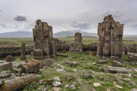 Ani, Turkey - May 9, 2019: Ruins of the old Armenian town Ani with churches and in the background snowy mountains, Turkey.