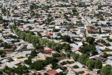 Osh, Kyrgyzstan - June 29, 2019: Rooftops of houses in Osh, the districts kapital, in Kyrgyzstan.