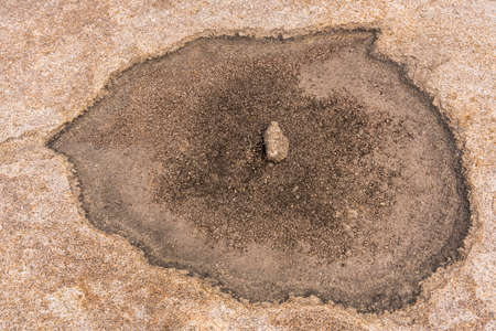 Rock formations and dry pit in Bektau Ata in Kazakhstan.