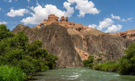 Charyn Canyon National Park with river in Kazakhstan on a summers day. Фото со стока