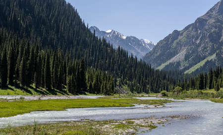 Karakol Valley with river and great mountains with snow in Kyrgyzstan. Фото со стока