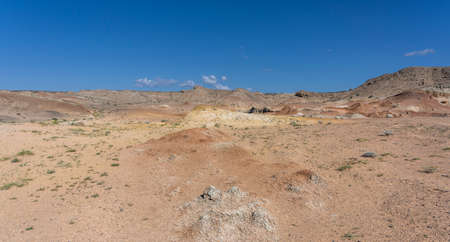 Colorful steppe and desert with hills and mountains in Mongolia.