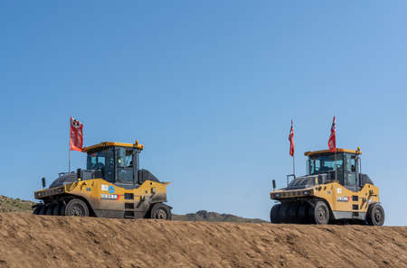 Numrug, Mogolia - August 10, 2019: Building a new road, the silk road, by Chinese companies in Mongolia with heavy yellow machines, like tarmac rollers. 에디토리얼