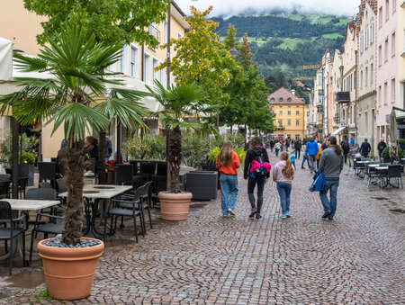 Brixen, Italy - October 4, 2020: the city of Brixen with terrace and shopping people in autumn.