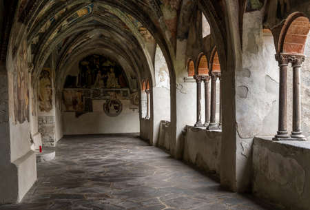 Brixen, Italy - October 9, 2020: Monastery with paintings, fresco, of the Cathedral of Brixen with roman architecture with pilars.