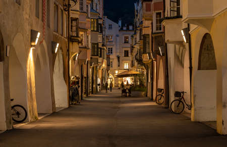 Brixen, Italy - October 9, 2020: City centre of Brixen at night with shopping district and old, historical houses.
