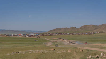 Numrug, Mogolia - August 10, 2019: The city of Numrug in the steppe of Mongolia with the old and the new road to the town.