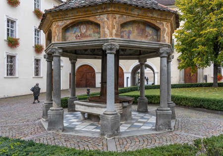 Brixen, Italy - October 9, 2020: Garden with arbor in the monastery of Abbazia di Novacella, Kloster Neustift in autumn in the Dolomites, Italy.