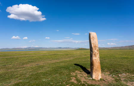 Deer standing stone on the steppe of Mongolia near Songino. 에디토리얼