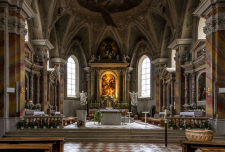 Brixen, Italy - October 4, 2020: Interior of the Sint Michael church of Brixen with the baroque architecture and altar. 에디토리얼