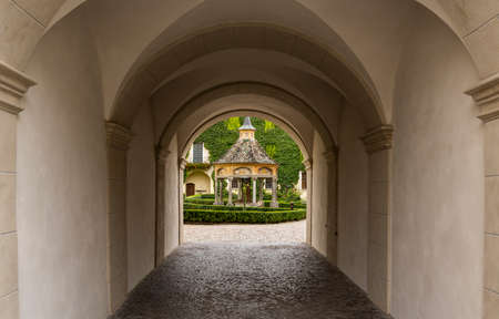Brixen, Italy - October 9, 2020: Gate with garden and arbor in the monastery of Abbazia di Novacella, Kloster Neustift in autumn in the Dolomites, Italy. 에디토리얼
