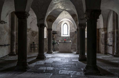 Innichen, Italy - October 4, 2020: Intirior of the Stiftskirche, church, the crypt with pilars and paintings, Innichen, Italy.