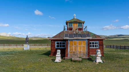 Burenhaan, Mongolia - August 12, 2019: Small, old Buddhist temple of red wood in the steppe of Mongolia, in Burenhaan.