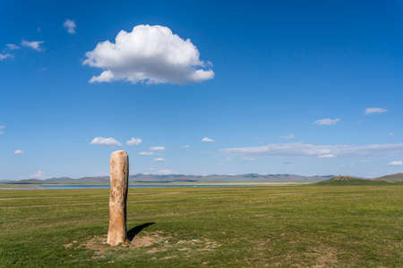 Deer standing stone on the steppe of Mongolia near Songino. Stock Photo
