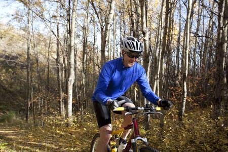 Man mountain biking photo