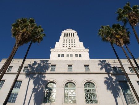 Palm trees frame the historic Los Angeles City Hall.