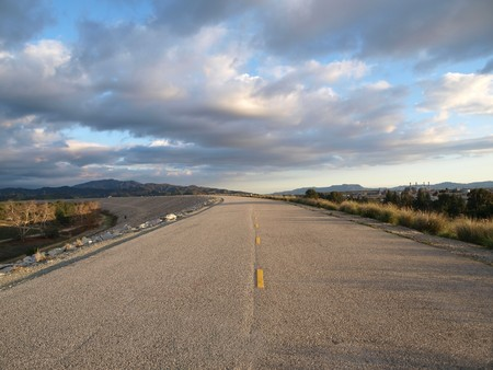 Levee road and California winter storm clouds  Stock Photo - 4295221