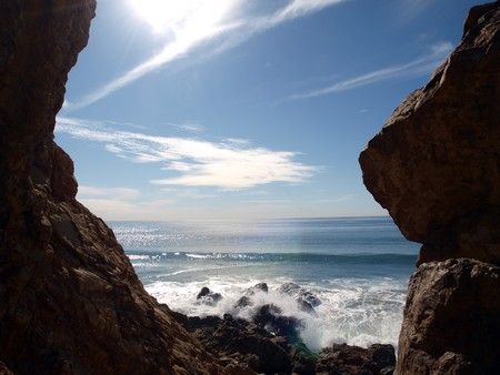 Crashing surf framed by a Malibu California rock formation Stock Photo - 4295214