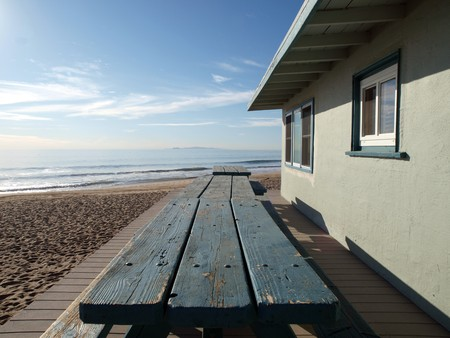 Picnic tables in front of a lifeguard office building Stock Photo - 4331124
