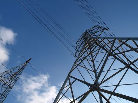 electric grid: Two electric towers rise into the blue California sky.