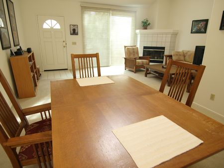 A dining room table inside a bright California townhouse.   Stock Photo - 4854822