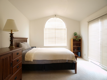 Guest bedroom in a bright California townhome.