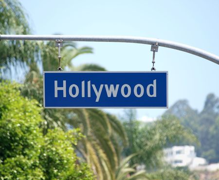 bl: Hollywood Blvd sign with palm tree backdrop.