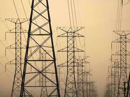 electric grid: Three power towers at sunrise in smoggy Southern California.