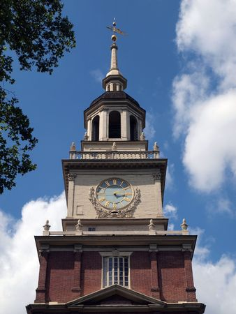 pa: The Clock Tower with cumulus clouds at Independence Hall National Park in Philadelphia PA.