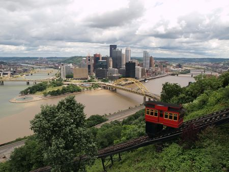 incline: Pittsburgh Pennsylvania river view, incline railroad and skyline with storm clouds.