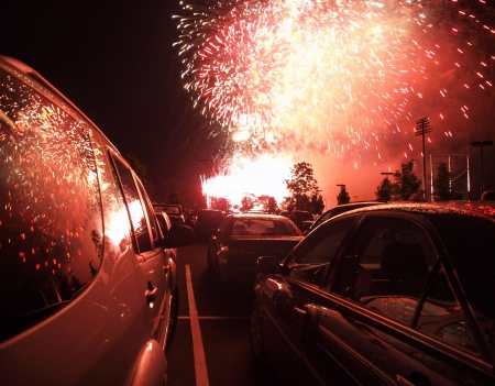 Autos and explosions.  A middle america parking lot party.       photo