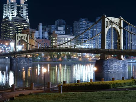 Riverfront park with graceful bridge in Pittsburgh Pennsylvania. Stock Photo