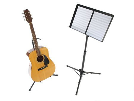 sheet: Acoustic guitar and music stand with blank sheet paper. Stock Photo