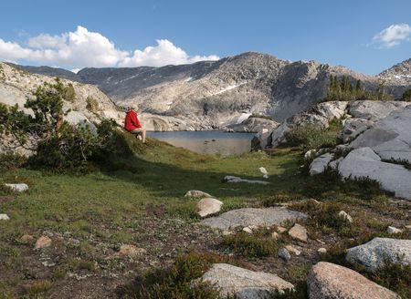 john muir wilderness: A hiker overlooks 10,568 Three Island Lake in the John Muir Wilderness of the Sierra National Forest.