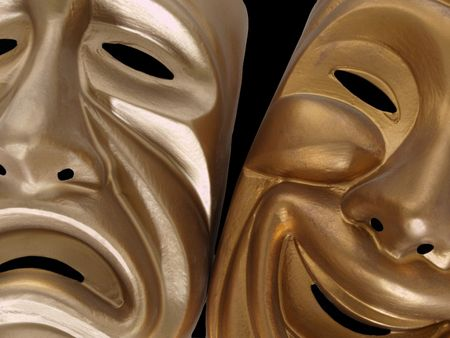 comedy and tragedy: Theatrical comedy and tragedy masks, isolated on black.   Stock Photo