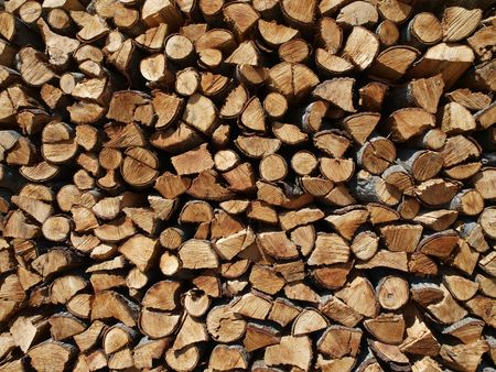 Giant stack of cut pine fire wood. Stock Photo - 5498775