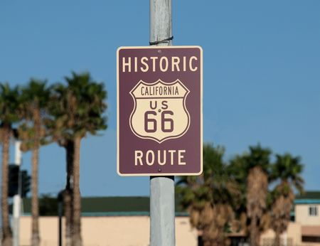 barstow: Historic route 66 sign with palm trees in Southern California