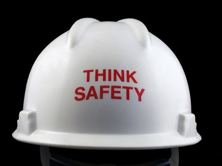 think safety: Think safety message on the back of a hard hat.  Stock Photo