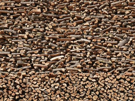 Towering stack of fresh cut pine firewood.  Stock Photo - 5537806
