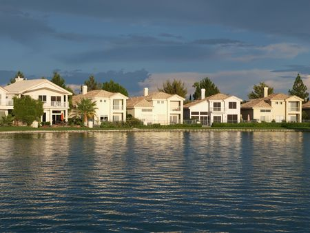 Lake front homes at sunset in Las Vegas Nevada.    Stock Photo - 5537807