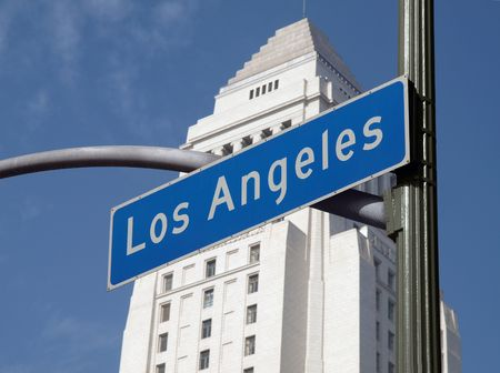 Los Angles street sign with iconic City Hall in background. Stock Photo