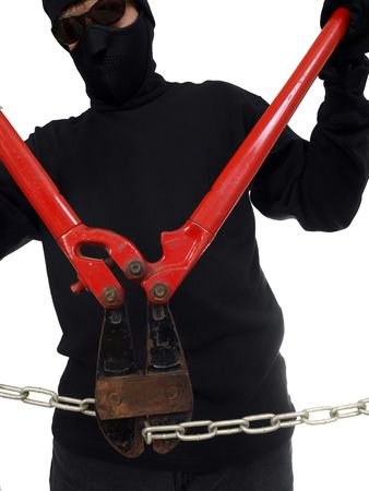 Masked man cutting a chain with well worn bolt cutters.   Stock Photo - 5620006