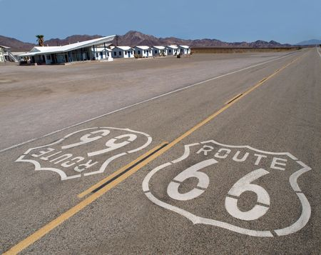 Route 66 sign with googie motel background in Californias Mojave Desert. photo