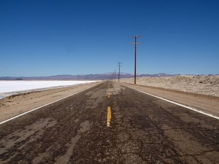 Desert dry lake salt flats along an old empty highway. Stock Photo - 5705760