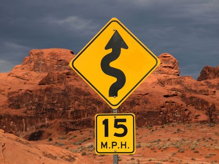Curve sign against red desert cliffs at sunset. Stock Photo - 5721083