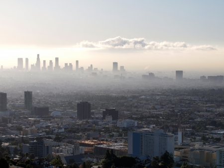 Misty Hollywood sunrise with Downtown Los Angeles in the background. Stock Photo