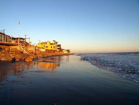 Warm beachfront sunset light in Malibu California. photo