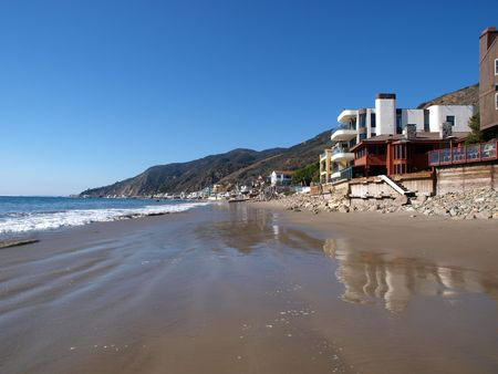 Malibu California beach life.  Row of homes along famous Toganga Beach.